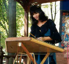 Barby playing hammered dulcimer